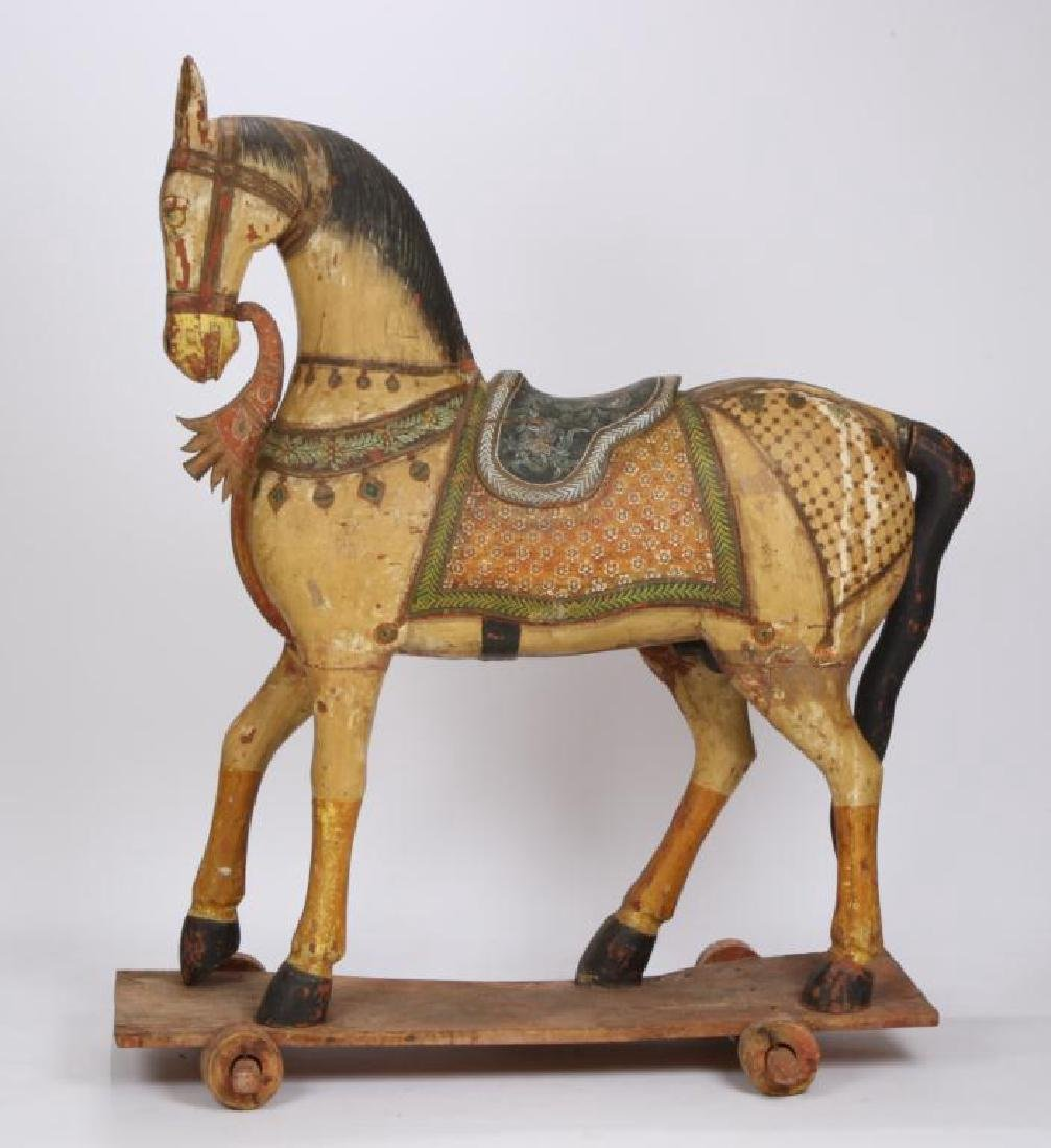 FULL SIZE CARVED AND PAINTED HORSE ON WHEELS