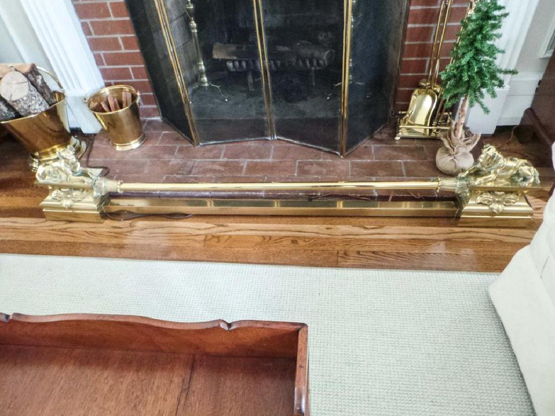 EXCEPTIONAL FIGURAL BRASS FIREPLACE FENDER