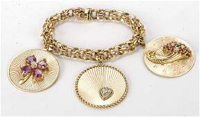 14K GOLD BRACELET WITH JEWEL ENCRUSTED CHARMS
