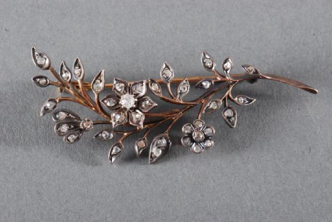 CLOSE SET DIAMOND FLORAL SPRAY BROACH