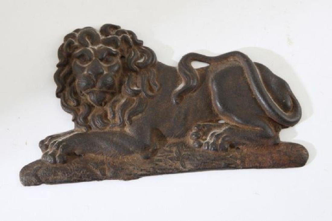 RECUMBANT LION CAST IN BAS RELIEF