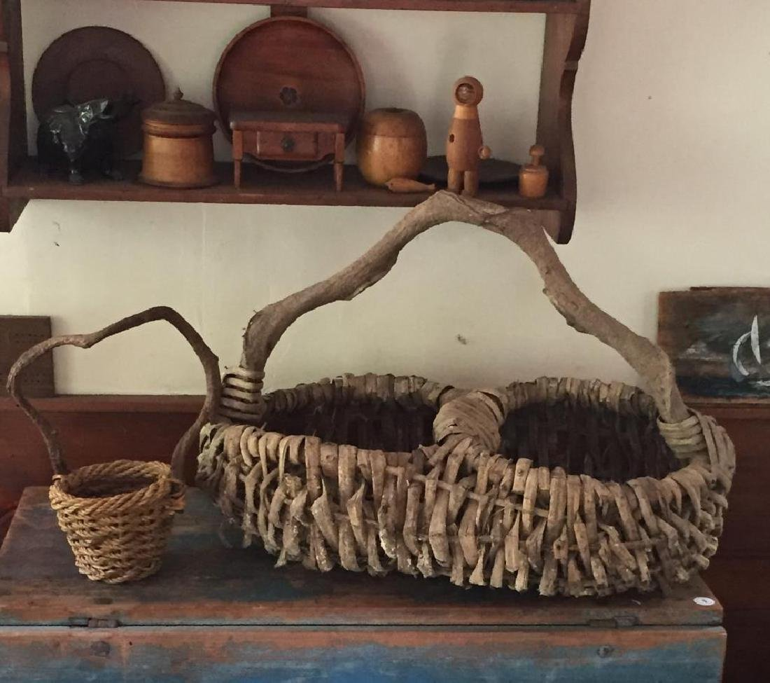 TWO RUSTIC ADIRONDACK BASKETS