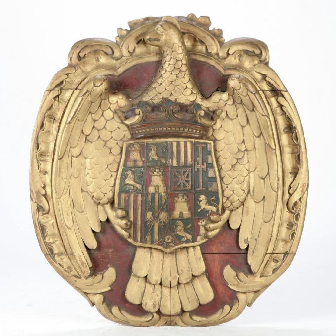 CARVED AND PAINTED WOODEN COAT OF ARMS
