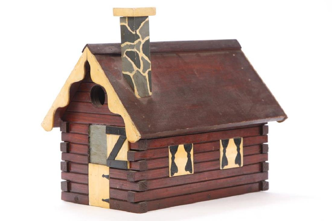 FOLK ART CARVED AND PAINTED LOG CABIN BIRD HOUSE