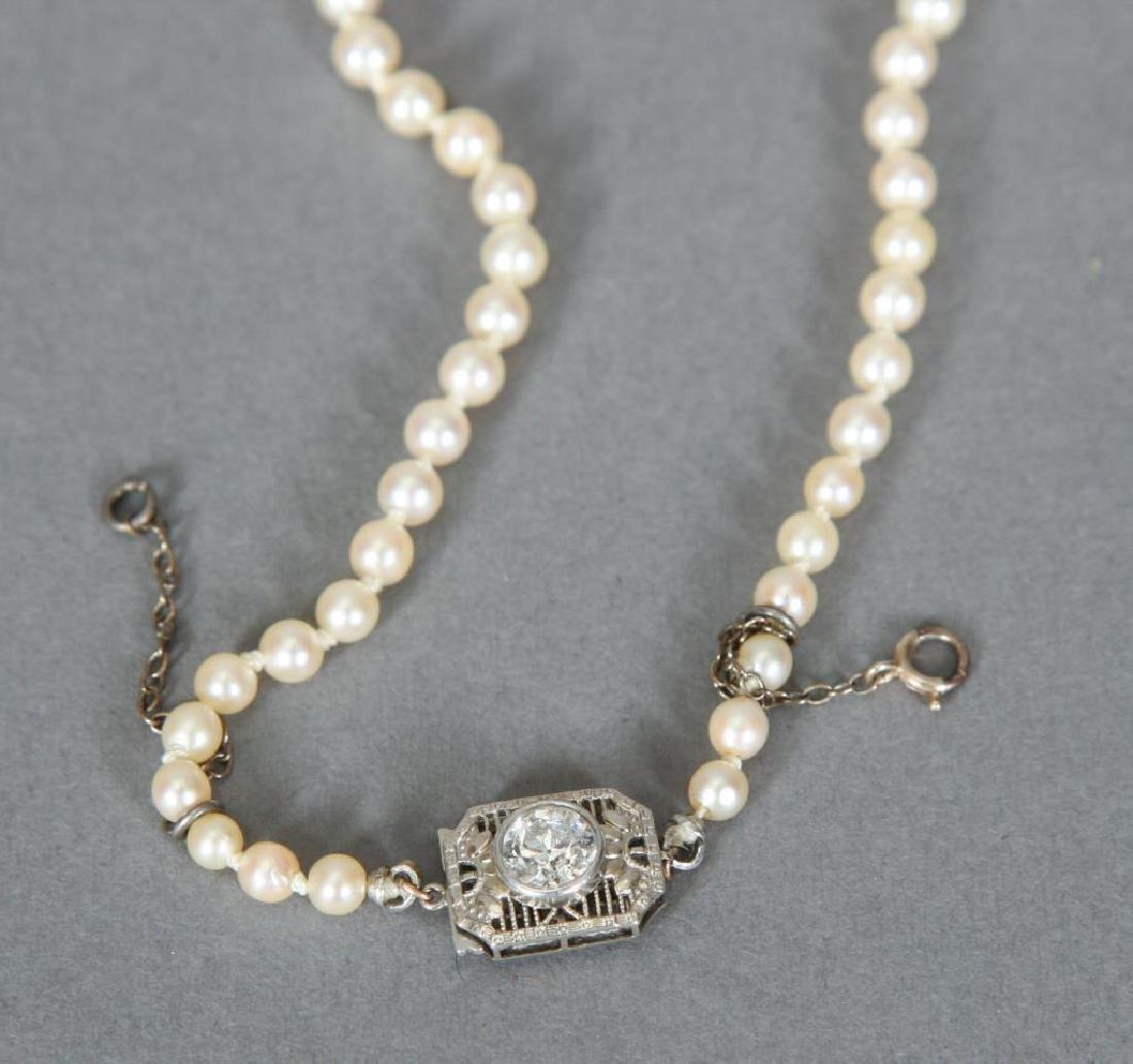 GRADUATING STRAND OF PEARLS with 1/2 CARAT DIAMOND - 4