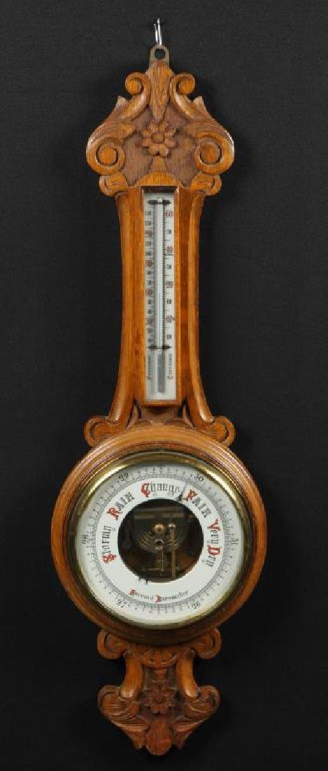 CARVED OAK ANEROID BAROMETER