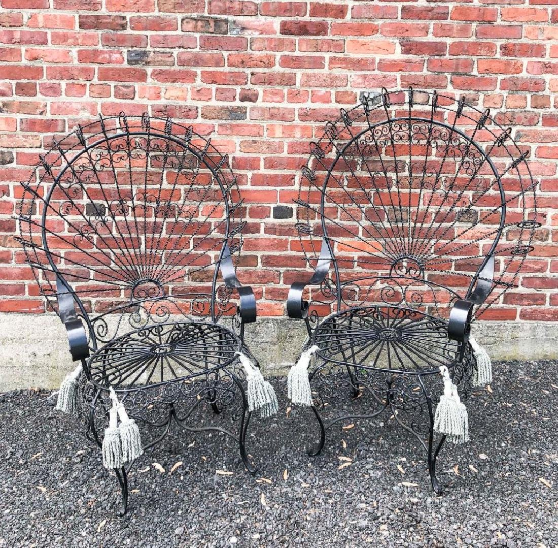 PAIR OF SPANISH TWISTED WIRE PEACOCK CHAIRS 50 inches.
