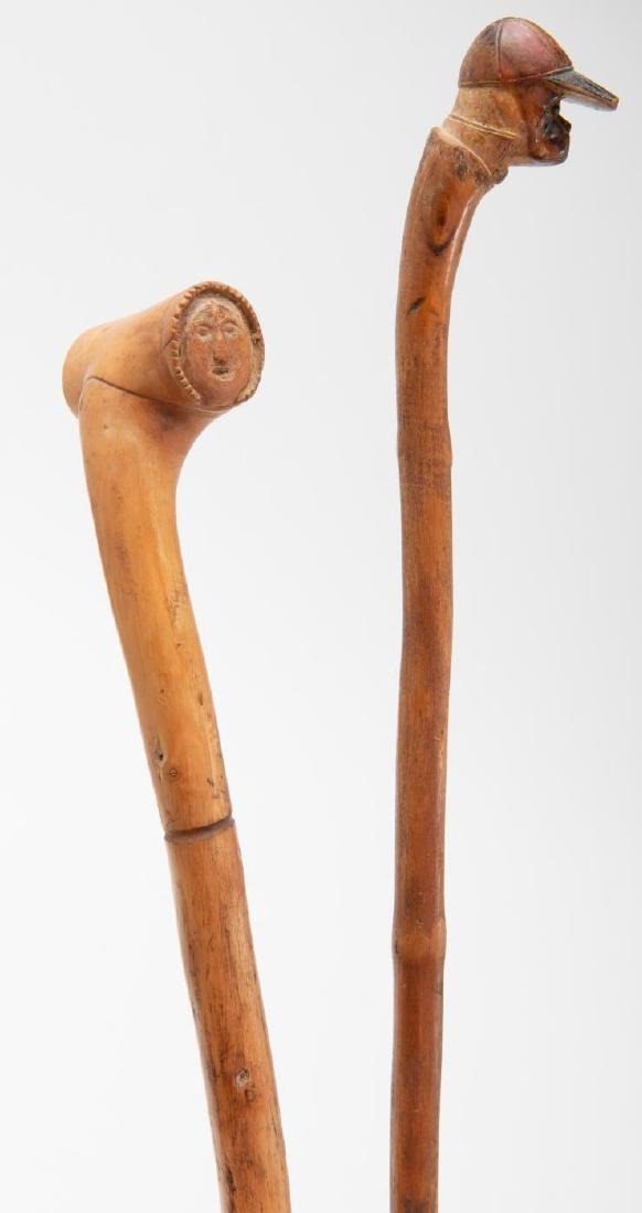 TWO (2) CARVED FIGURAL CANES