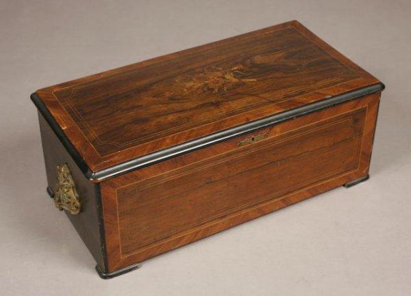271: A Victorian period Swiss music box haing a very un