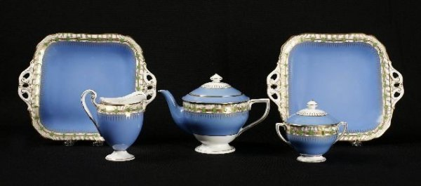 853: Royal Worcester three piece tea set and two handle