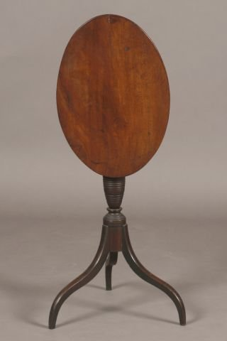10: Mahogany oval tilt top candlestand with spider legs