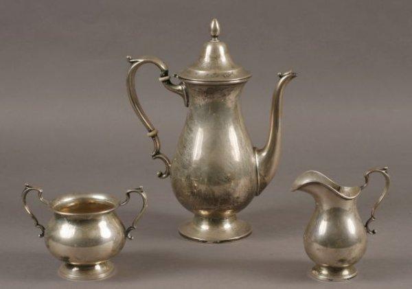11: Three piece sterling tea set