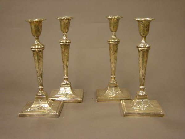 20: A set of  four English silver Adams period candlest