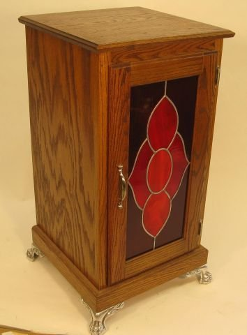 421: Contemporary oak cabinet with leaded glass door