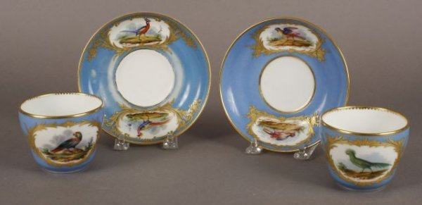 536: Pair of French porcelain cups and saucers each in