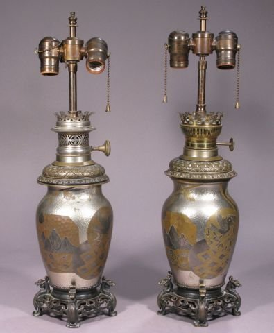 795: Pair of Authetic movement mixed metal oil lamps.