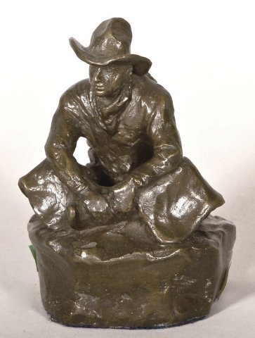 125: Bronze of seated cowboy signed O' Wieghorst