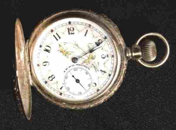 657: Lady's 14k gold hunter's case watch. The dial is e