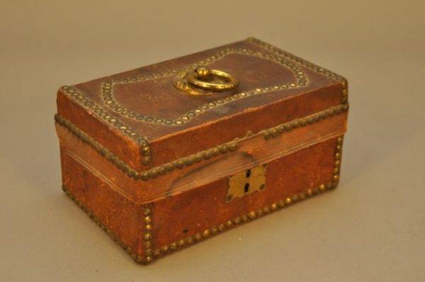 12: Very fine leather document box with brass tacks, da