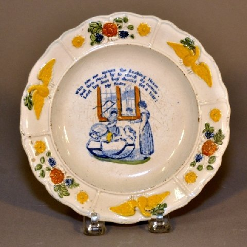 23: Child's early soft paste plate with scene of child