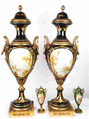 PAIR OF MONUMENTAL ORMOLU MOUNTED PORCELAIN URNS