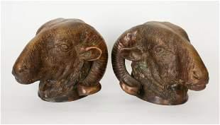 PAIR OF CAST BRONZE RAM'S HEAD WALL ORNAMENTS