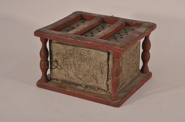7: 18th century foot warmer in red paint with punched t