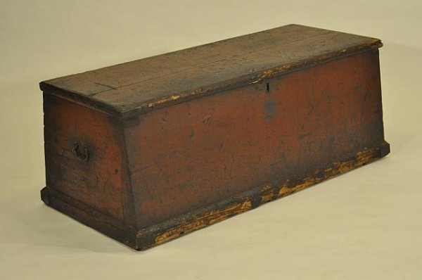 12: Early dovetailed sea chest in old red paint on a mo