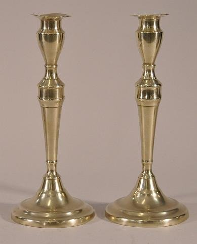 13: Pair of 18th century brass push up candlesticks. He