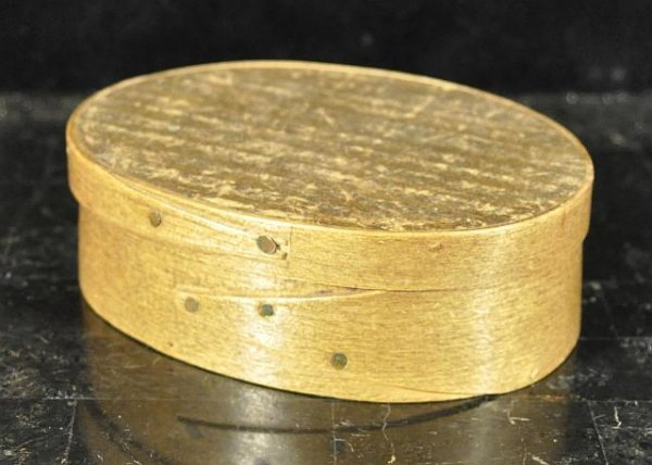 15: Oval covered hammered pantry box