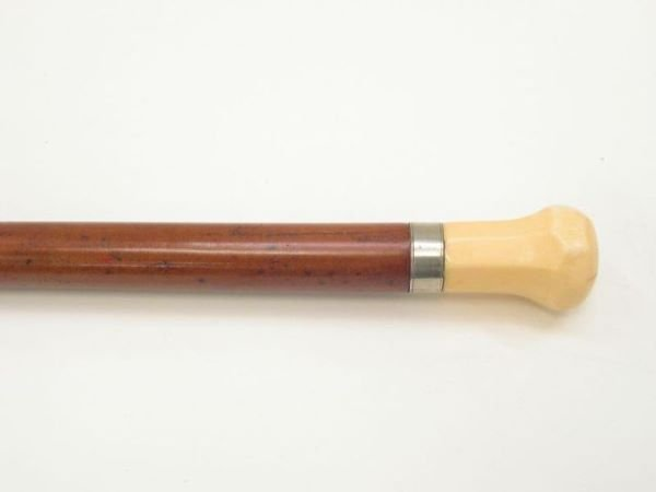 700: Ivory mounted walking stick.  The ivory knob with