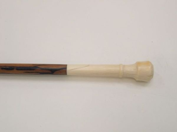 703: Ivory mounted cane (#7).  The elongated know handl
