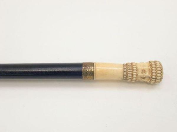704: Bone mounted dress cane.  The cylindrical bone kno