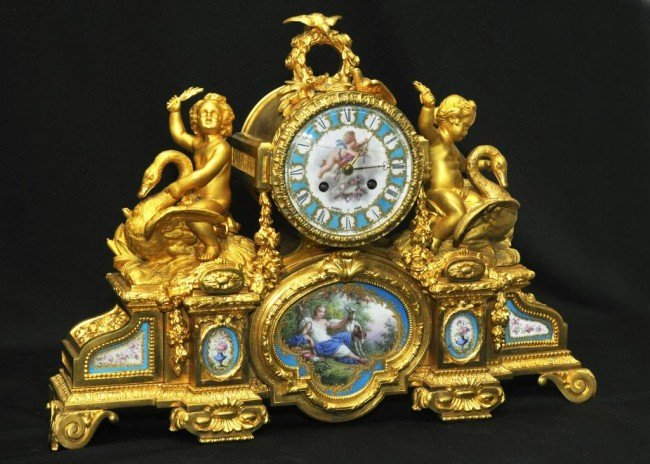 5: Louis XVI style gilt bronze and mantle clock with tw