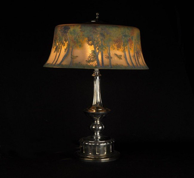 20: Pairpoint lamp. The shade decorated with trees and