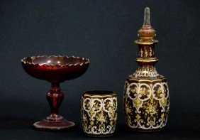 414: Lot of four pieces of Bohemian ruby enameled glass