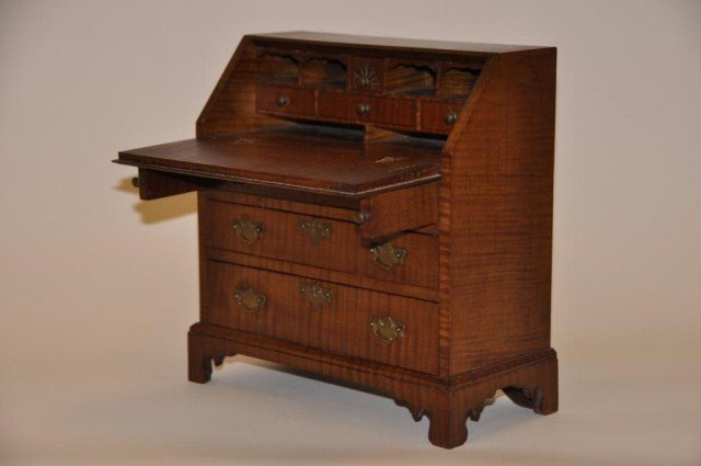 43: Well crafted miniature tiger maple Chippendale