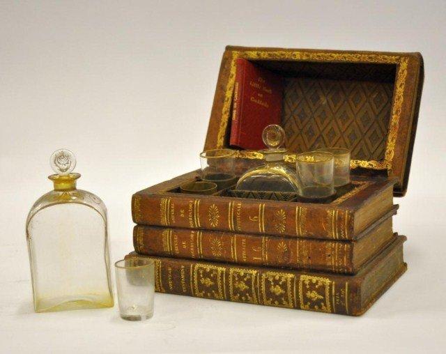 50: French cased liquor set, O.W. Holmes