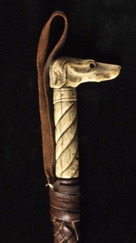56: Riding crop with dog head bone carved handle