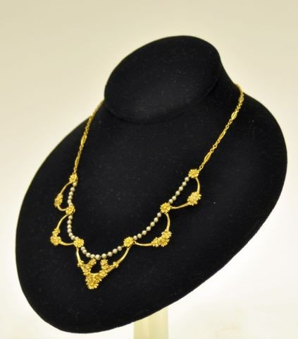 244: Fine quality 18k Gold and pearl necklace
