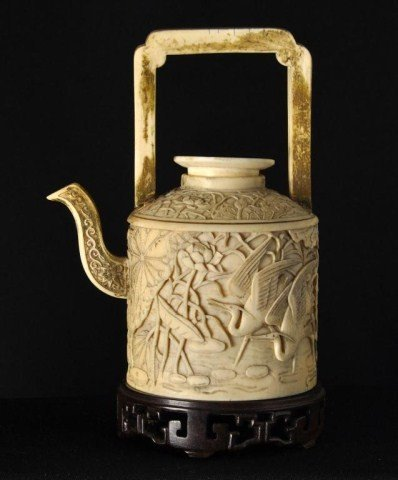 11: Chinese carved ivory pouring vessel
