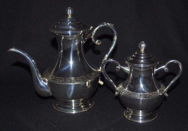 56: Two piece silver tea service with Greek key pattern