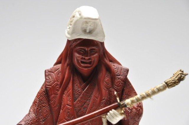 104: Finely covered cinnabar and ivory figure