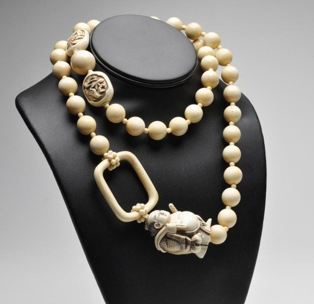 106: Japanese ivory necklace with signed netsuke