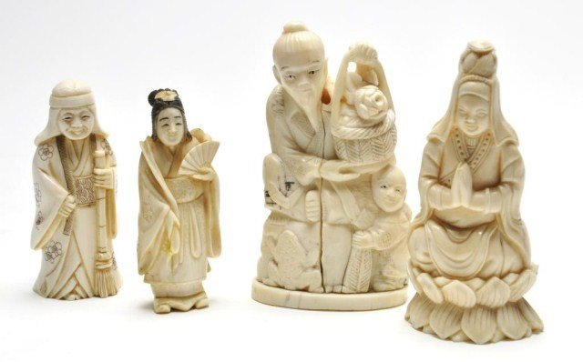 107: Four assorted Japanese ivory figural carvings