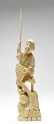 111: Japanese ivory of a man holding fan and pole