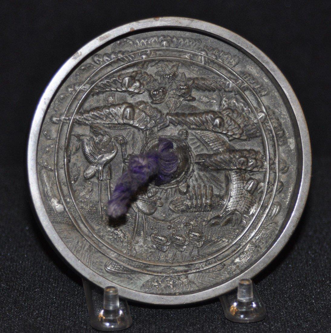 31B: Cast bronze hand mirror