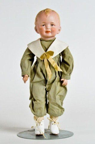 "7: 13"" Bisque head boy doll, incised ""9027"""