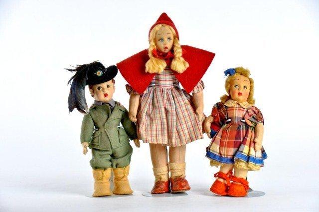 12: Lot of three cloth dolls