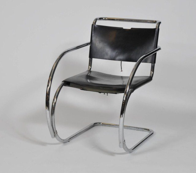 4: Mid century bent chrome and leather arm chair